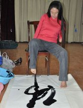 Writing Chinese Calligraphy Art with Mouth and Feet